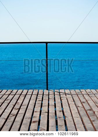 Marine minimalism. Sea, sky and faded wooden platform.