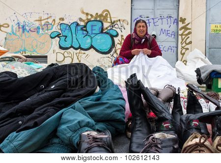 Gipsy Woman Selling Clothes