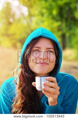 Young Woman Holding Cup Of Coffee Or Tea And Smiling. Beautiful Young Blonde Woman Drinking Takeaway
