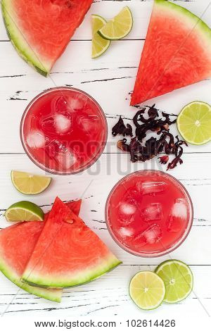 Watermelon hibiscus lime cooler - refreshing summer drink with lime and mint. Top view