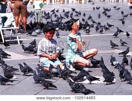 Feeding the pigeons, Venice.