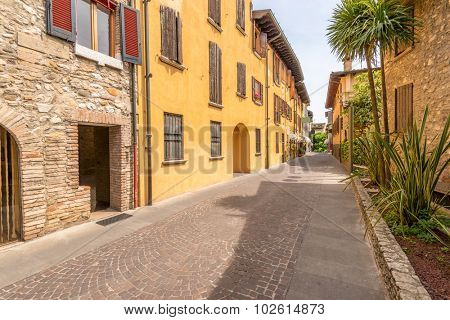Picturesque small town street view in Sirmione, Lake Garda Italy.