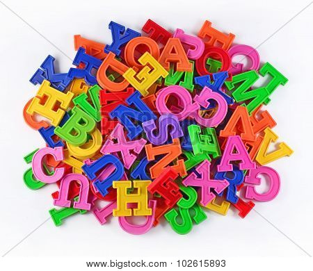 Heap Of Plastic Colored Alphabet Letters On A White