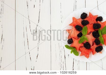 Refreshing watermelon salad with blackberries and mint. Fresh star shaped watermelon. Copy space bac