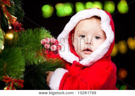 Baby Decorating Christmas Tree