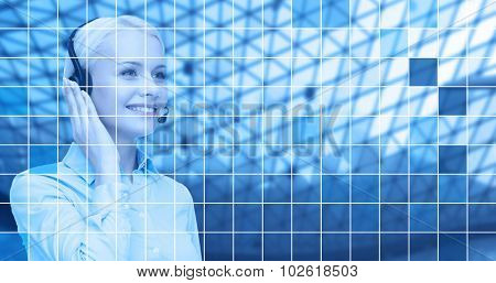 business, people, technology and communication concept - happy female helpline operator in headset over blue grid background