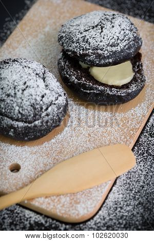 Pastry With Icing Sugar / Pastry / Pastry With Icing Sugar On Black Background