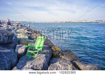 Green Chair On Rocks At Bosphorus Bank
