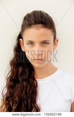 Angry preteen girl with blue eyes outdoor