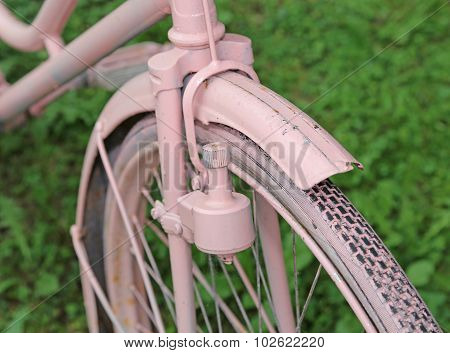 Detail Of Old Bicycle With The Bottle Dynamo Device For The Headlight On The Front Wheel