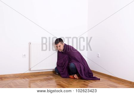 Man With Blanket Beside Heater