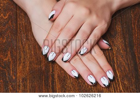 Black And White  Nail Art On Wooden Background