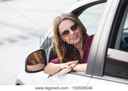 Beautiful lady looking away from her car