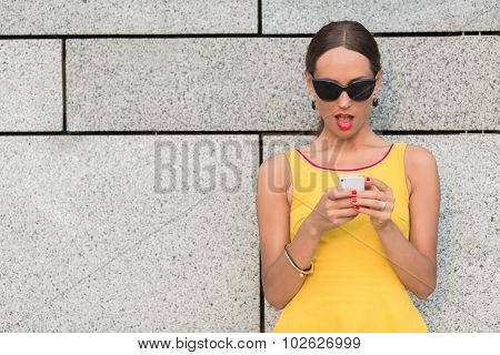 Fashion girl with mobile phone