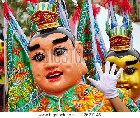 Two Masked Dancers At A Temple Carnival In Taiwan