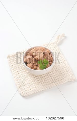 bowl of tuna chunks on white mat