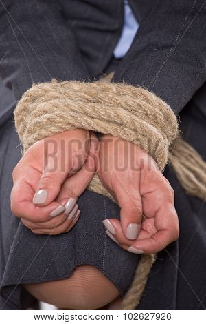 Tied up hands with rope