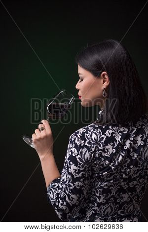 Asian woman drinking red wine