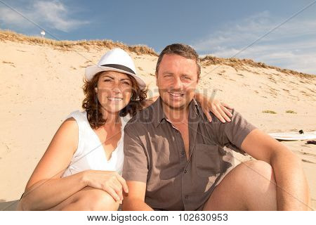 A Cheerful Couple Happy On The Beach