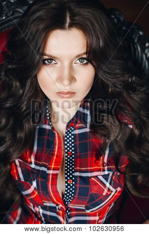 beautiful sexy brunette woman in plaid shirt
