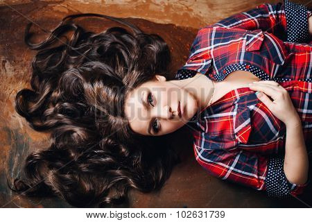 beautiful sexy brunette woman in plaid shirt