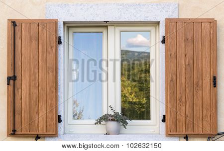 Window With Open Wooden Shutters