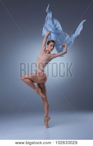 The beautiful ballerina dancing with blue veil