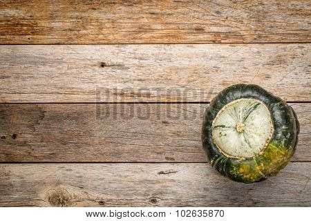 buttercup winter squash on a grunge weathered barn wood with a copy space