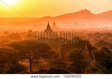 Pagoda landscape under a warm sunset in the plain of Bagan, Myanmar (Burma)