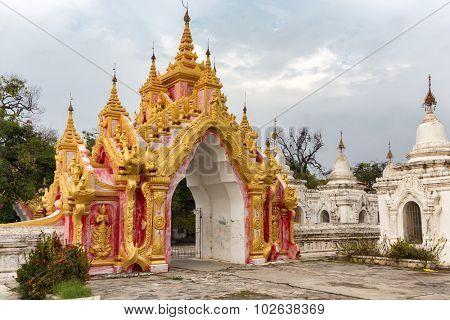 Burmese pagoda traditional gate in the Kuthodaw pagoda, Mandalay, Myanmar