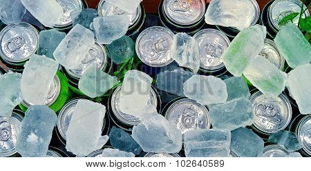 Cans of drink on ice cube