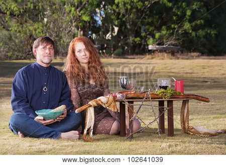 Pagans With Smudge Stick And Altar