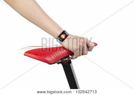 Woman Hand Holding Bike Seat Wearing Health Sensor Smart Watch