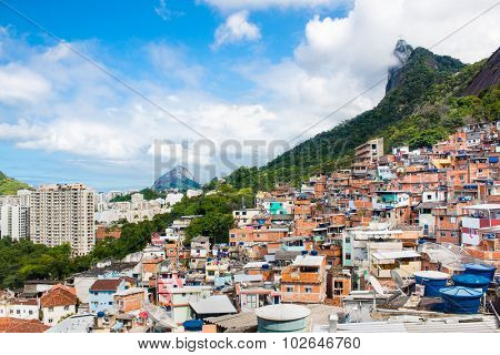 Buildings of Favela Santa Marta with Corcovado mountain behind in Rio de Janeiro, Brazil.