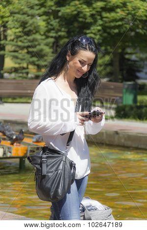 Caucasian Brunette In Sunglass With Mobile