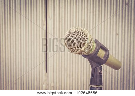 Microphone In The Background Of Galvanized Iron With Extremely Shallow Dof. : Vintage Style Filter,