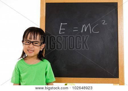 Asian Chinese Little Girl Againts Blackboard With Formulas