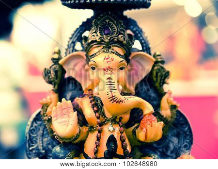 Yellow Ganesh Elephant God In Hindusim Mythology In Rich King Pose With Multi-hands Emperor Crown An