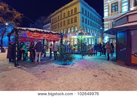 People At A Christmas Market In Riga's Old Town