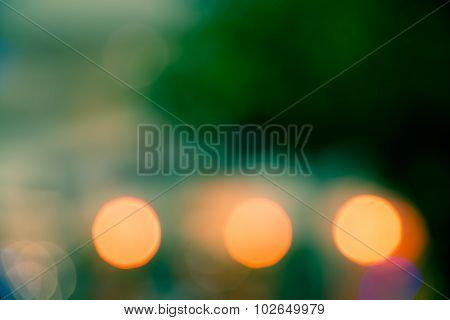 Green And Orange Glowing Light Bokeh Blur Abstract Of City Life Background Split-tone