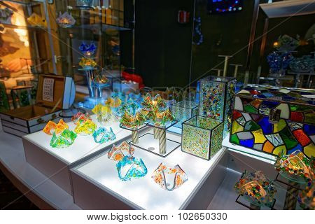 Christmas Stand With Souvenirs Made Of Colored Glass