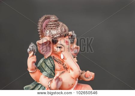 Orange Ganesh (ganapati- Elephant God) In Hindusim Mythology Closeup Hold The Weapons Maze And Axe P