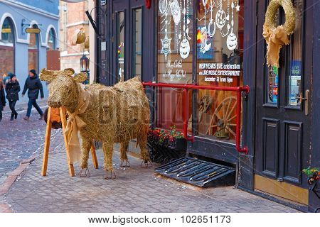 Little Straw Bull Figure At The Entrance To A Restaurant