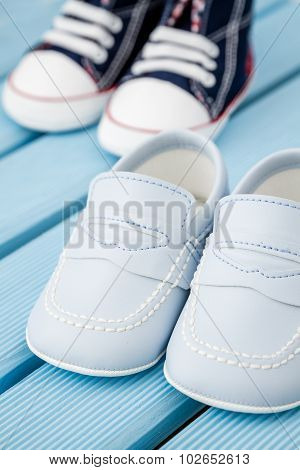 Pairs Of Dark Blue, White Baby Sneakers And Blue Baby Shoes