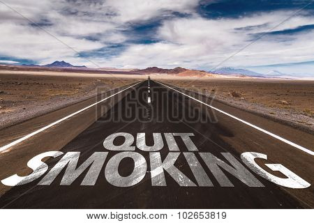 Quit Smoking written on desert road