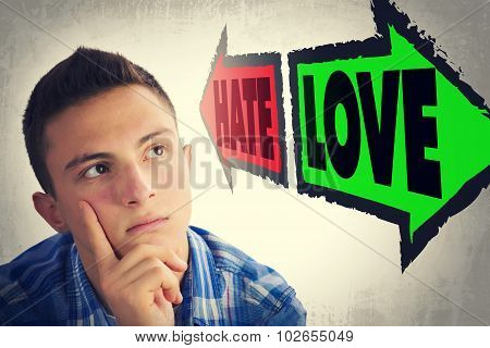 Portrait Of Handsome Teenager Faced With Choice Between Hate And Love