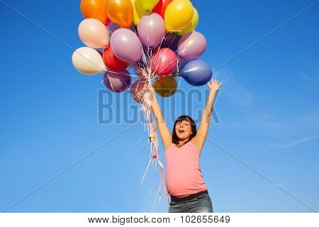 Beautiful Happy Young Pregnant Woman Girl Outdoors With Balloons On Sky Background  With Her Hands U