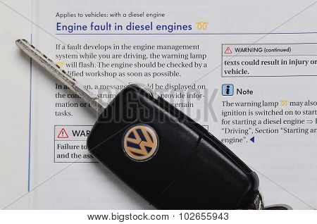VW owners manual with car key