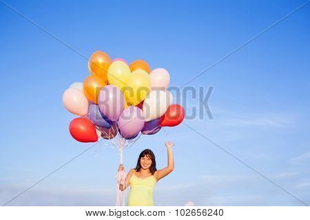 Beautiful Happy Young Pregnant Woman Girl Outdoors With Balloons On Sky Background Making Salute