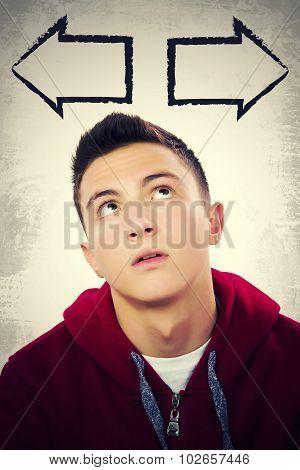 Portrait Of Handsome Teenage Boy In Dilemma